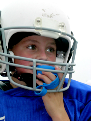 Salem, OR boy football player wearing a mouthguard to protect his braces.